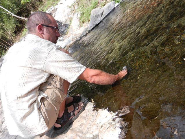 Mike taking the water temperature with his watch.